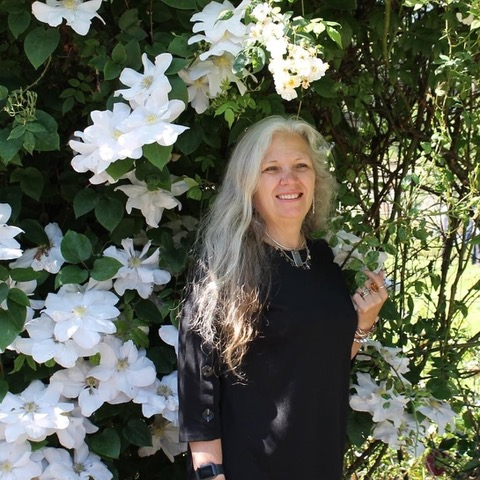 An image of Betty Jane Ware standing in a garden.